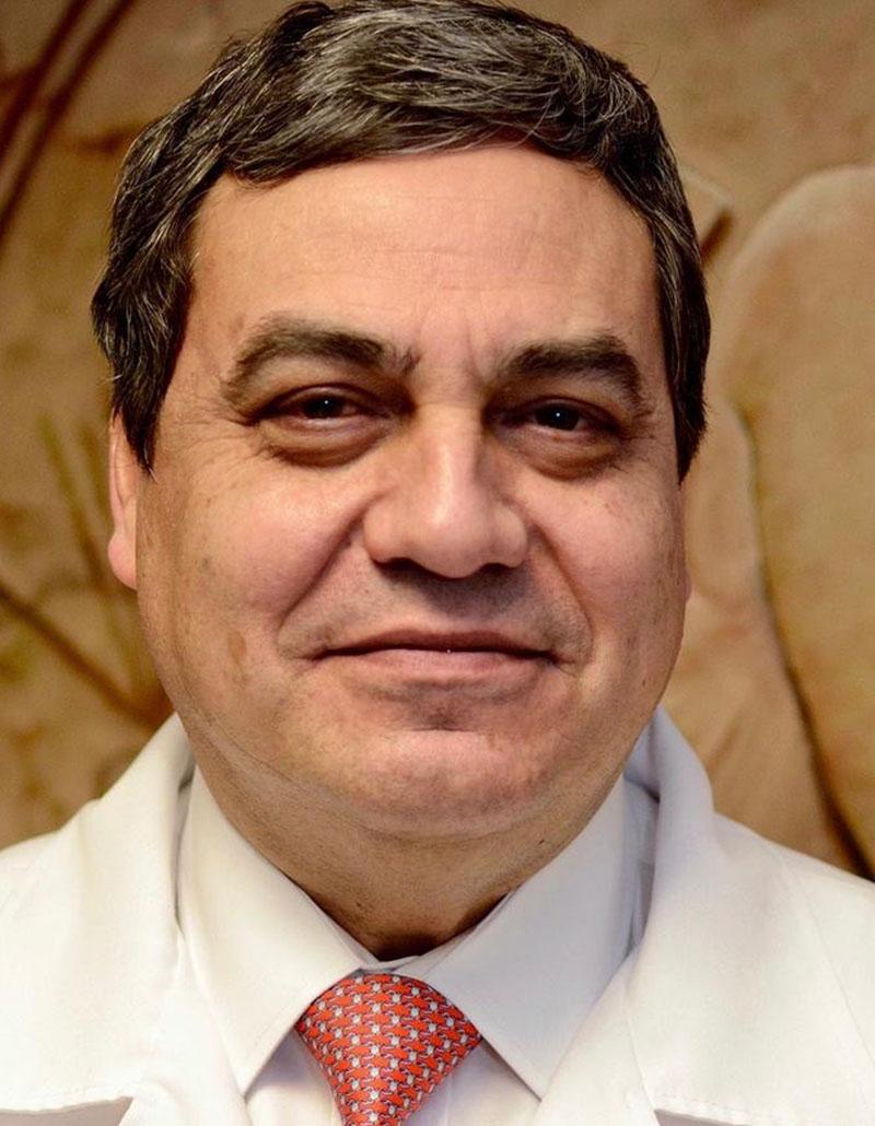 Dr. Carlos De la Torre González